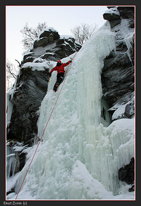 Ice Climbing. S' at the top of the frozen waterfall