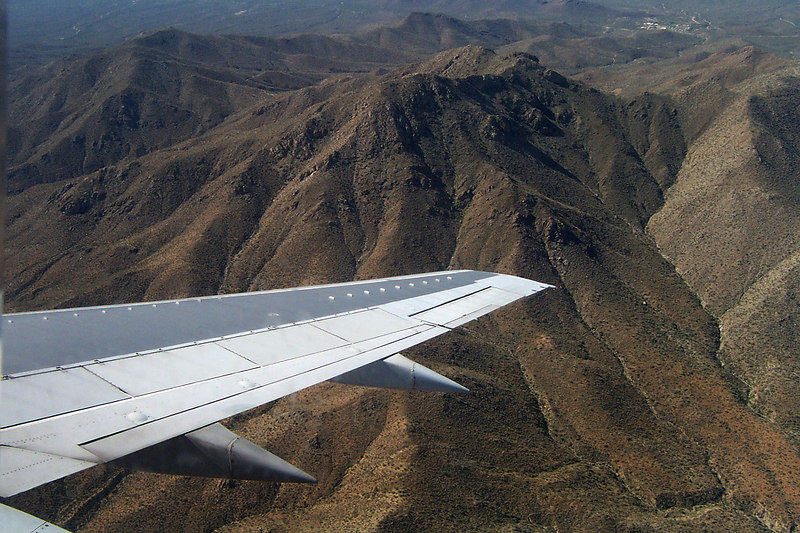 Flying low over the mountains west of Tucson as we approach the airport.