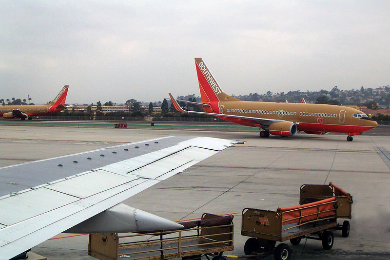 Friday morning at the San Diego airport. Watching the planes roll by through the window of our 737 as we wait for it to take off for Tucson, Arizona.