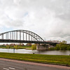 """John Frost Bridge, """"A Bridge Too Far"""", crosses the Rhine River at Arnhem, The Netherlands.  Frost commanded the British 2nd Parachute Battalion, 1st Airbone Division during Operation Market Garden, 1944.  The 750 man Battlion held the bridge for four days.  Completely surrounded by German Panzer divisions, they surrendered with only 100 men remaining."""