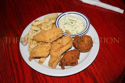 Catfish, fries, hushpuppies and cole slaw at The Catfish Warehouse Tunica, Mississippi