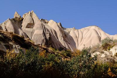 Softened by erosion.
