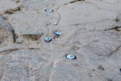 The blue evil eye embedded in the streets.
