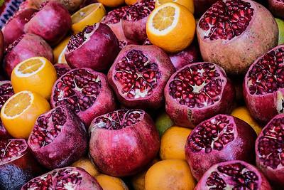 Pomegranates and oranges.