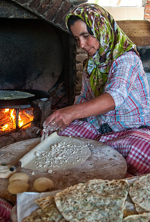 A village woman demonstrating the preparation and cooking of gozleme, a delicious stuffed flat bread.