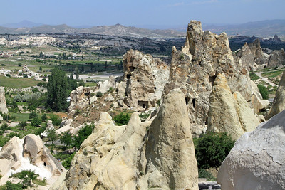 Goreme Open-Air Museum - View over the valley towards Goreme, showing some of the rock cut dwellings.