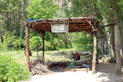 Local woman preparing food at outdoor cafe, Ihlara Valley, Cappdocia.