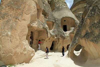 Dwellings cut into cone-shaped fairy chimneys, Zelve, Cappadocia.