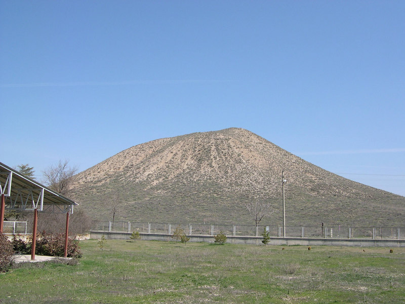 This enormous mound, 300 meters wide by 53 meters tall, is called the Tomb of King Midas, although most likely it contained his predecessor, King Gordion.  It was entered by archeologists in the 1950s, who found the burial intact, an amazing occurance.  The burial furniture is now in the museum in Ankara, although the burial chamber is still intact and can by reached through a tunnel into the mound.