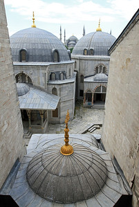 View over the (mausoleum) domes and interior courtyard of Haghia Sophia to the Blue Mosque.