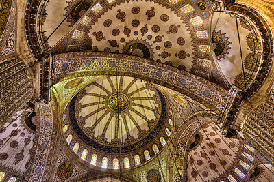 The Sultan Ahmed (Blue) Mosque was constructed between 1609 and 1616 during the rule of Ahmed I. It  contains Ahmed's tomb, a madrasah and a hospice. The mosque has five main domes, six minarets and eight secondary domes.  It is next to the Hagia Sophia,