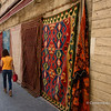 File Ref: 2013-06-04-Istanbul  277<br /> Young girl walking in a side street drapped with turkish carpets for sale. Istanbul