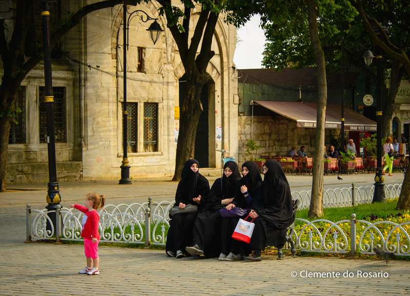 File Ref: 2013-06-04-Istanbul  186<br /> Young teenage girls in traditional muslim black dress in Sultanahmet Meydani Square Istanbul Turkey