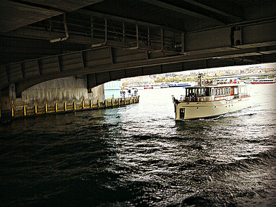 Boat passing under Galata Bridge