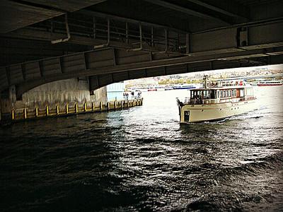 Boat passing under Galata Bridge