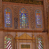 Some of the interior of the Blue Mosque, which has finely carved and sculptured marble, with a stalactite niche and a double inscriptive panel above it.