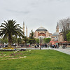 Aya Sofya = Hagia Sophia, viewed from the Hippodrome park amid April tulips.<br /> The huge Byzantine Church, begun in 537 A.D., with its 30 meter dome was unprecedented and structurally challenging in the earthquake prone area of Constantinople (Istanbul). <br /> It was converted to a mosque May 29, 1453 until 1931.  Now it is a museum.