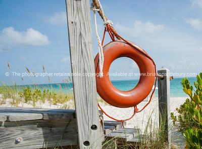 Lifebuoy on Providenciale beach, Turks & Caicos Islands. Prints & downloads.
