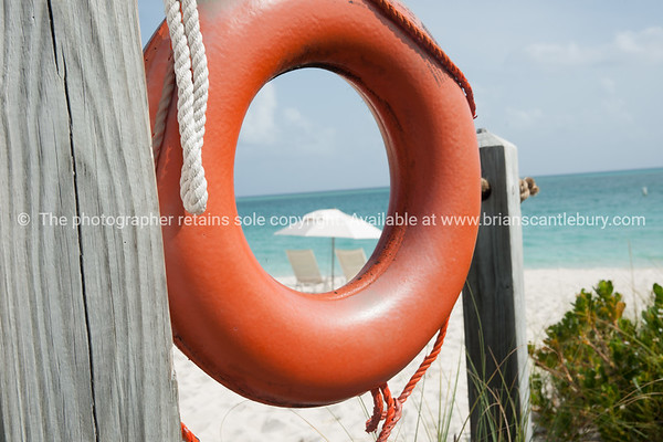 Lifebuoy on Providenciale beach, Turks & Caicos Islands.<br /> Prints & downloads.