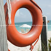 Lifebuoy on Providenciale beach, Turks & Caicos Islands.<br /> Prints & downloads.