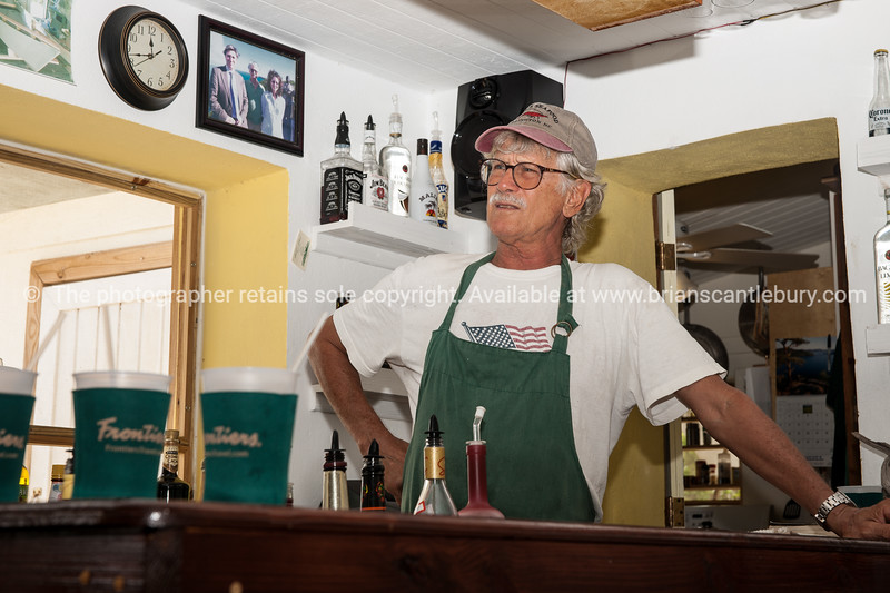 "Howard in his ""Last Chance"" bar and restaurant, North Caicos, Turks and Caicos.<br /> Model release; no."