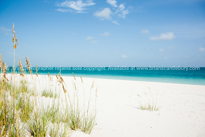 Beach, Caribbean white sand, turquoise sea, and blue sky. Providenciales, Turks & Caicos. Prints & downloads.