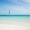 Beach, Caribbean white sand, turquoise sea, and blue sky. Providenciales, Turks & Caicos. Beaches Resort yacht.<br /> Prints & downloads.