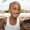 A smiling Jacko shows off the gap in his teeth.<br /> Jacko Owoh, Blue Hills, Providenciales, Turks & Caicos.<br /> Model release; No.