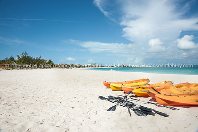 Kayaks on beach, Caribbean white sand, turquoise sea, and blue sky. Providenciales, Turks & Caicos. Prints & downloads.