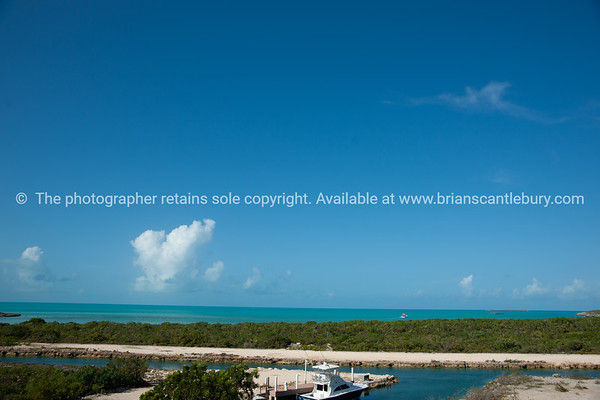 Beach, Caribbean white sand, turquoise sea, and blue sky. Providenciales, Turks & Caicos.