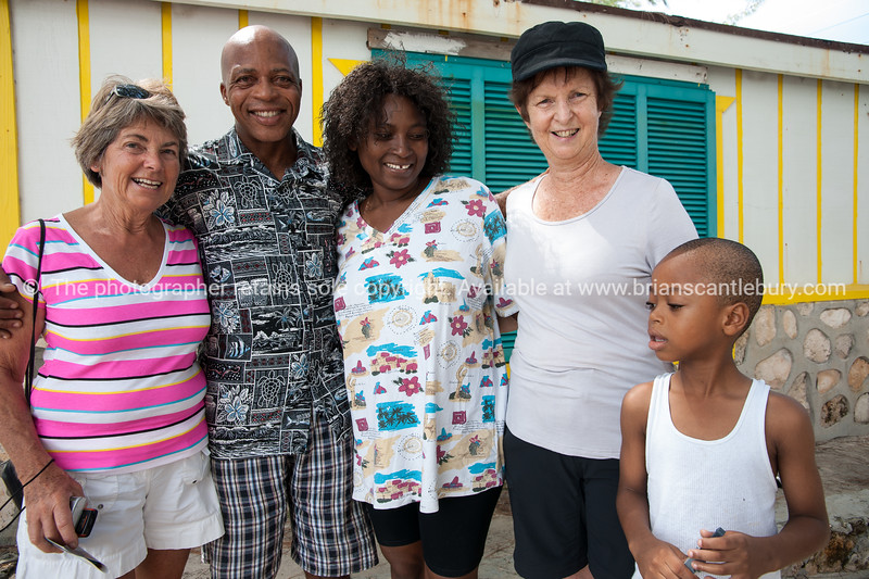The Owoh family, with Anne and Andrea, outside their church & home, Blue hills, Providenciales, Turks and Caicos.<br /> Model release; No.