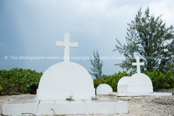Graves on beach at Providenciales, Turks & Caicos.<br /> Prints & downloads.
