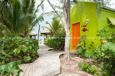 Blue Hills,  Providenciales, walkway to beach restaurant, with lime green restroom building. Prints & downloads.