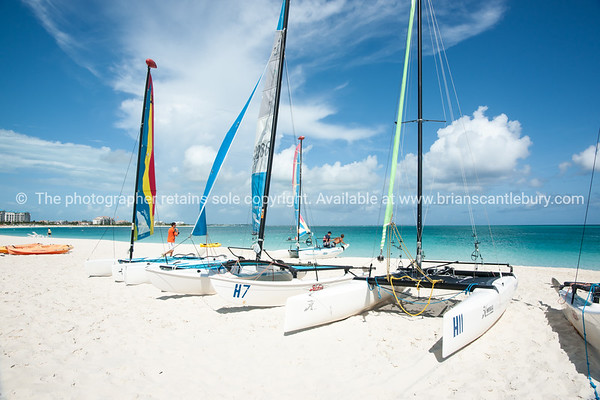 Catarmarans on beach, Caribbean white sand, turquoise sea, and blue sky. Providenciales, Turks & Caicos.<br /> Prints & downloads.