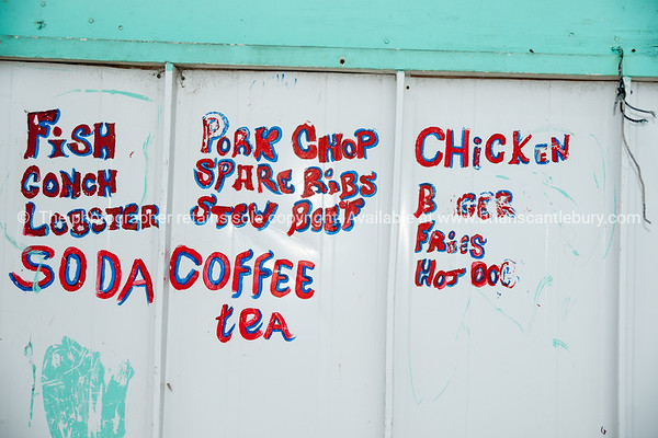 Rough food sign, Blue Hill, Providenciales, Turks & Caicos.<br /> Prints & downloads.