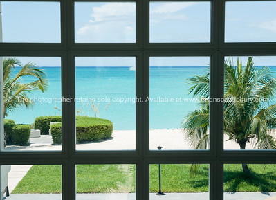 Beach through window, Caribbean white sand, turquoise sea, and blue sky. Providenciales, Turks & Caicos.