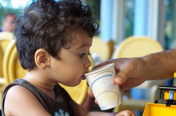 Daddy helping Jaden drink his juice