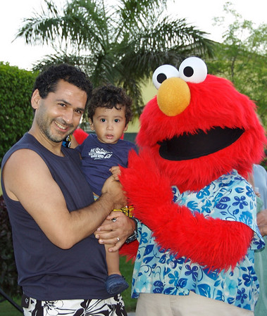 Jaden gets a hug from Elmo