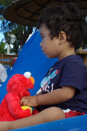 Jaden and Elmo on the long beach chairs