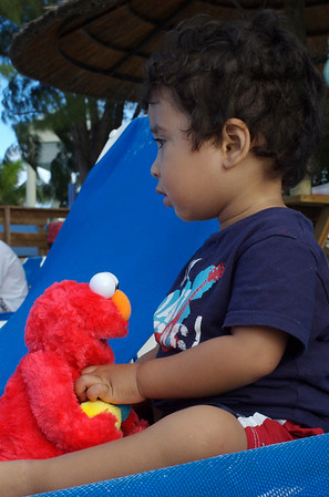 Jaden and Elmo on the long beach chairs