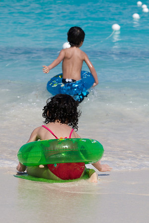 Cyane and Jaden hitting the surf with their floaty things
