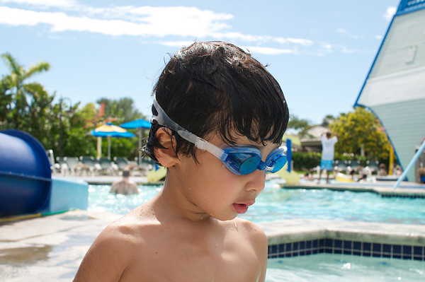 I love Jaden's googles.  Here we are hanging out at the kid's water park, Treasure Island.