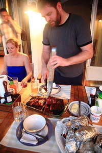 Geoff carves his barbecue sauce-smothered creation.