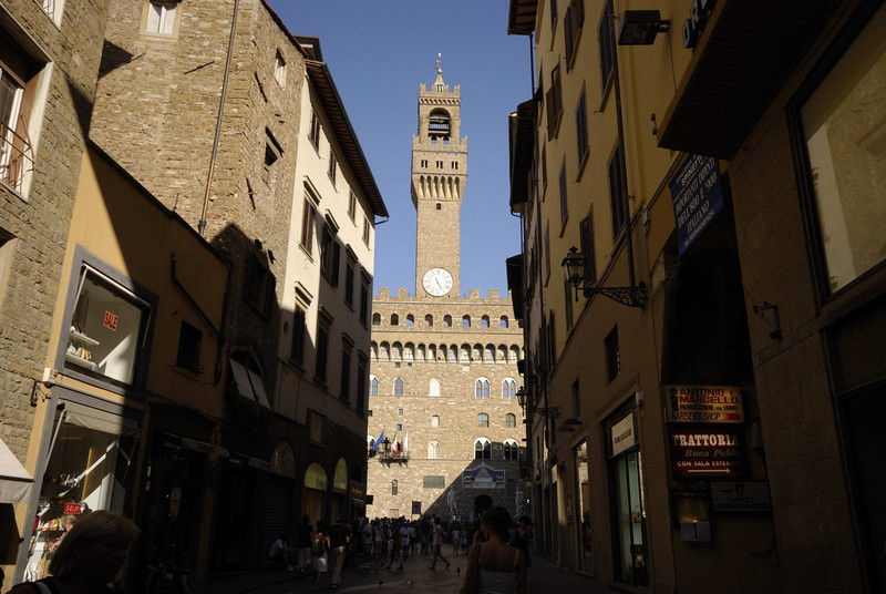 The Campanile of the Palazzo Vecchio (1322), Florence. Can just see Michaelangelo's statue of David (1504).