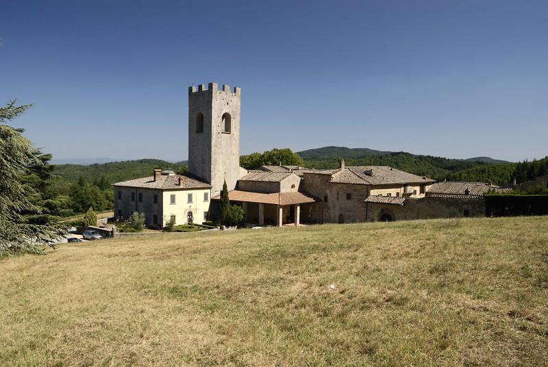 Badia a Coltibuono, the Romanesque abbey church and its mighty campanile, 11th century,central Tuscany.