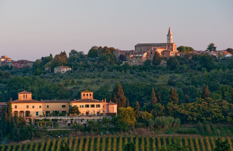 Vineyards and olive groves surround this small village in the Chianti region of Tuscany.