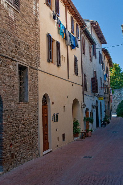 Narrow street, complete with drying clothes, in the village of San Gimignano in Tuscany.