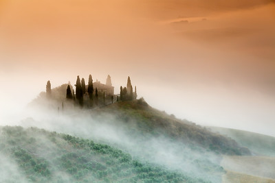 Amazing foggy sunrise in countryside of Tuscany, Italy