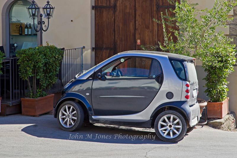 Small car in Radda, Chianti region of Tuscany, Italy