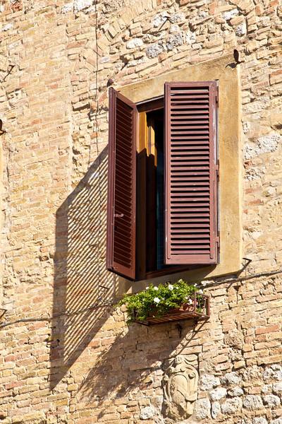 Window shutters and shadows, San Gimignano, Tuscany, Italy